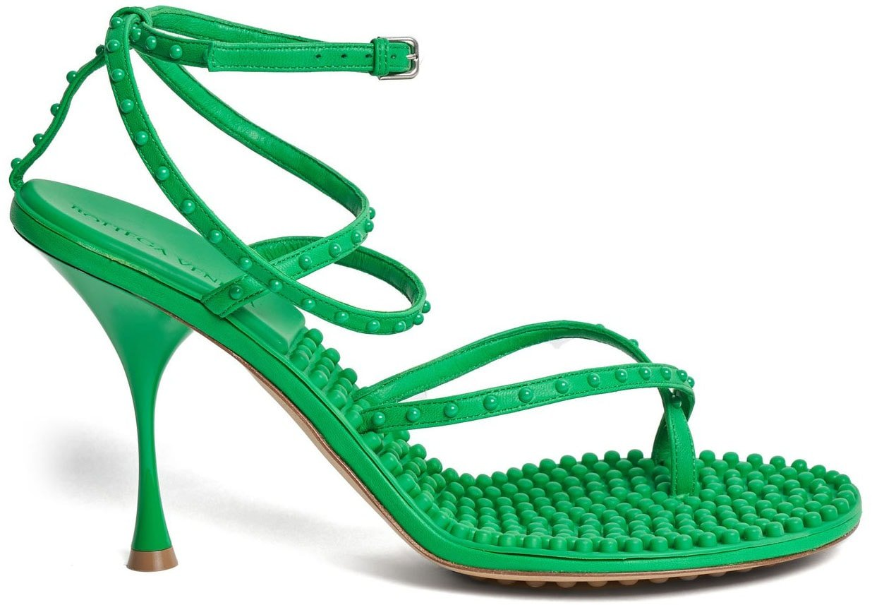 Bottega Veneta's Lagoon sandals with toe rings and ankle straps also come in green colorway
