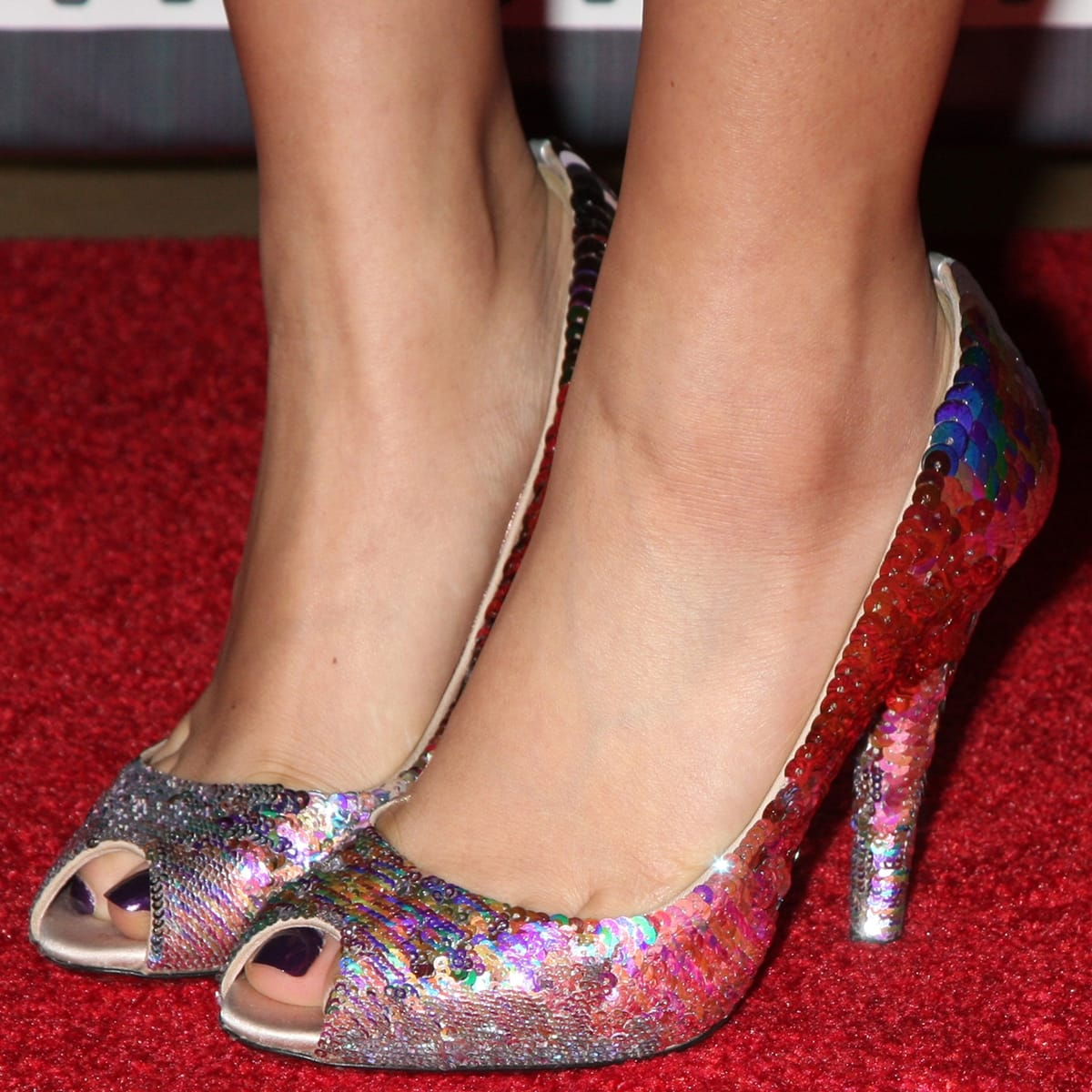 Brenda Song shows off her feet in high heels on the red carpet