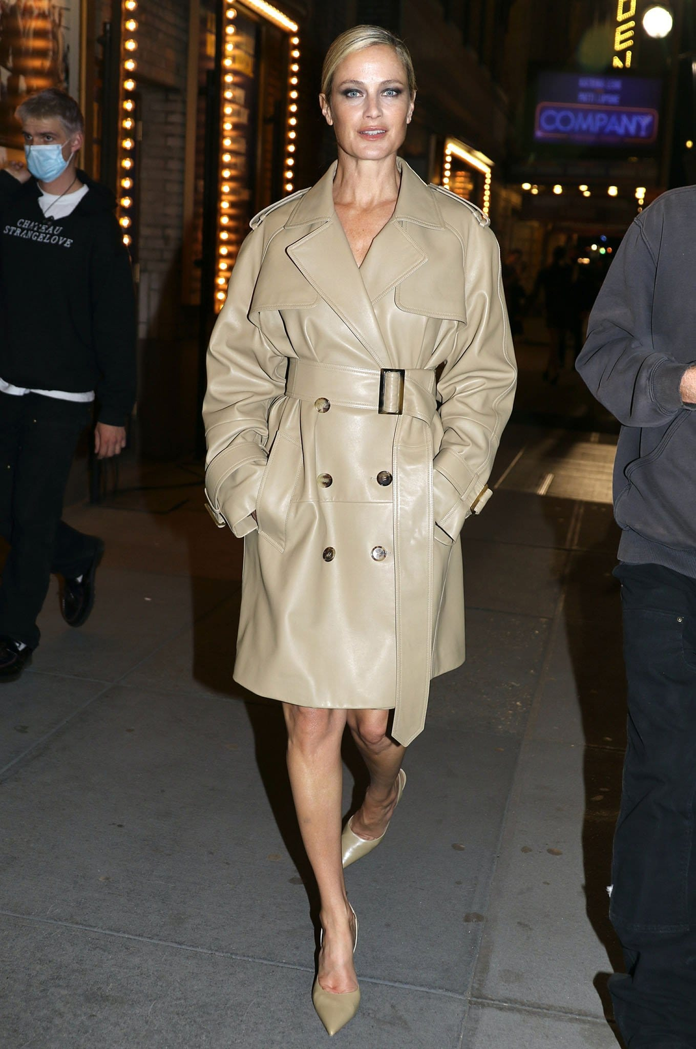 Carolyn Murphy defines tres chic in leather trench coat and matching slingback pumps