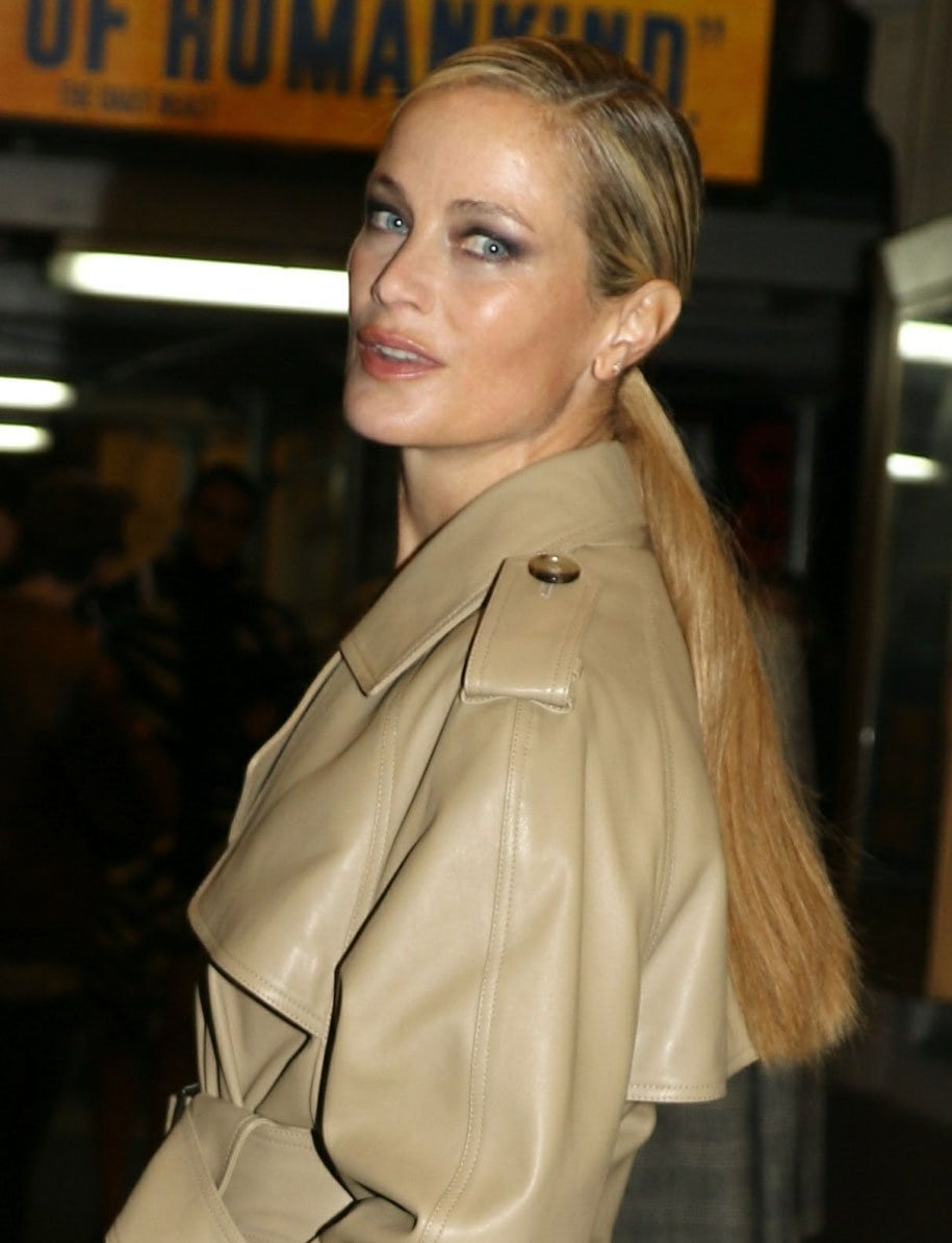 Carolyn Murphy ties her long blonde locks back into a neat side-parted ponytail