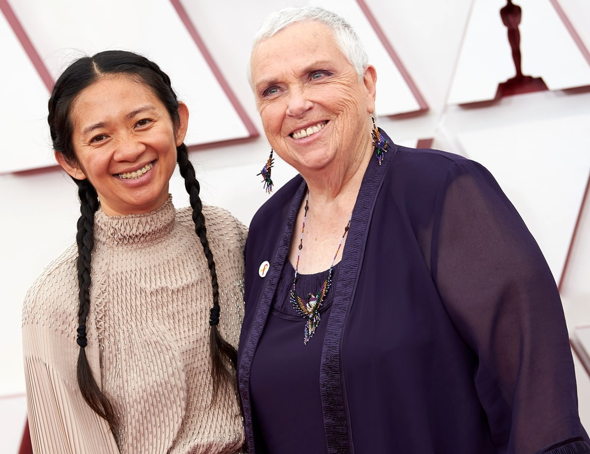 Nomadland real-life star Charlene Swankie posing with Chinese filmmaker Chloé Zhao