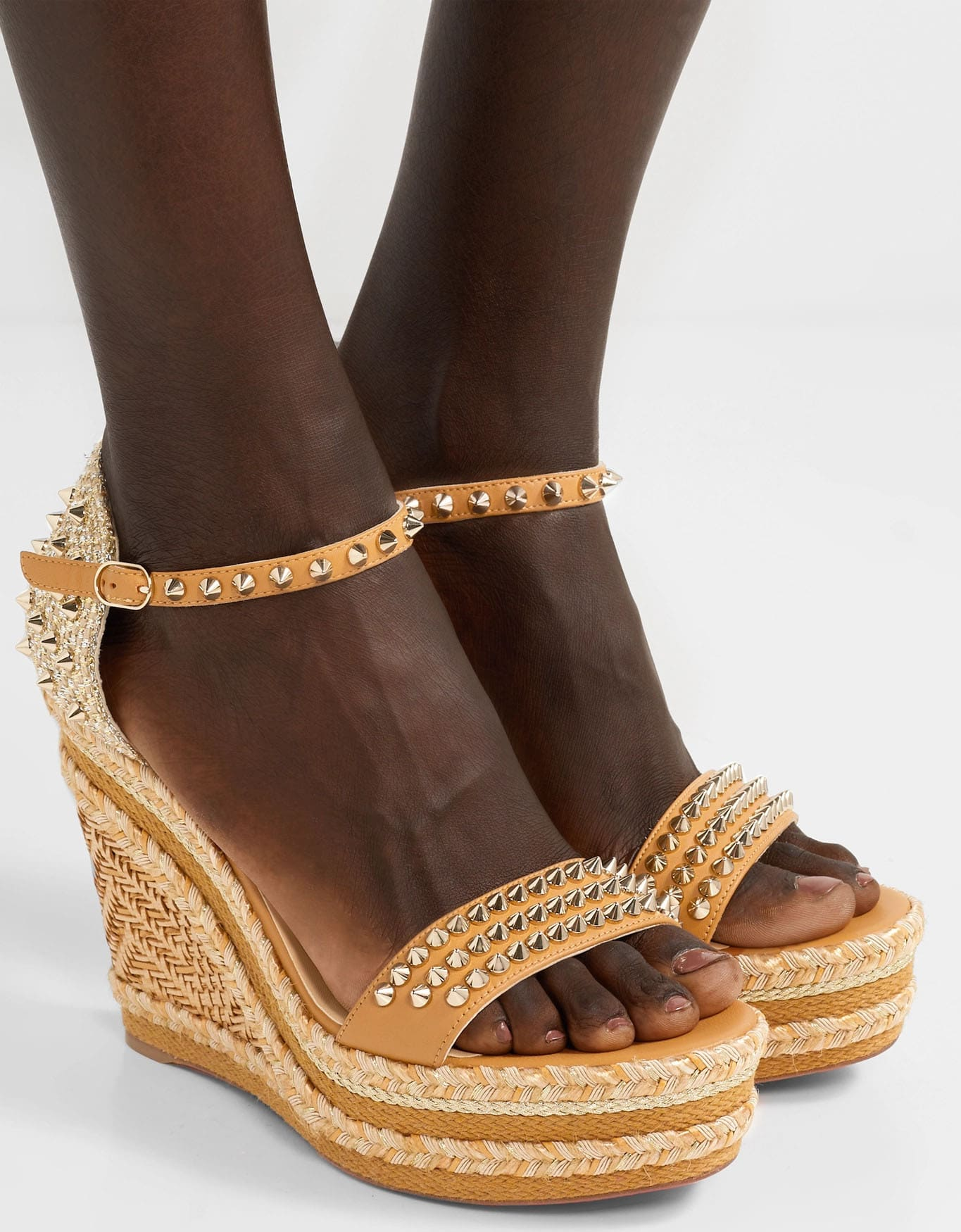 Christian Louboutin's Madmonica espadrille wedges are dangerously chic with golden spike studs and raffia trims