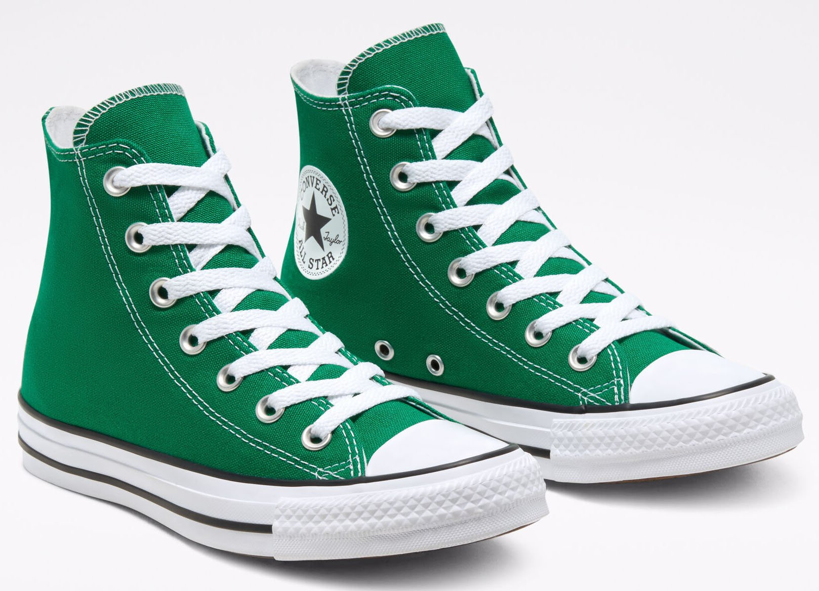 The Converse Colors Chuck Taylors come in fresh Amazon Green colorway and have the iconic Chuck Taylor ankle patch and classic woven tongue label
