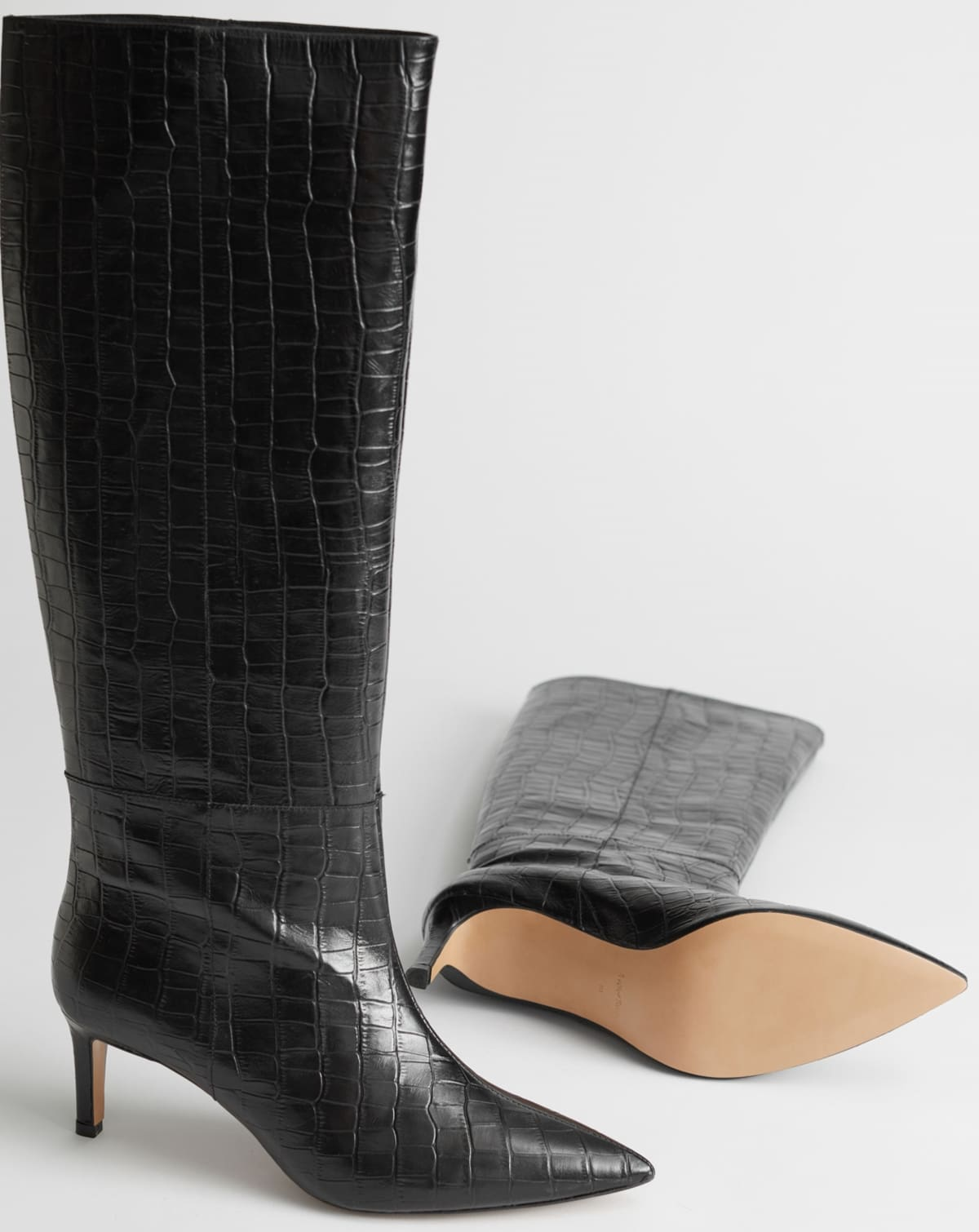 Croc embossed leather boots with slim, '90s-inspired stiletto heels and a pointed silhouette