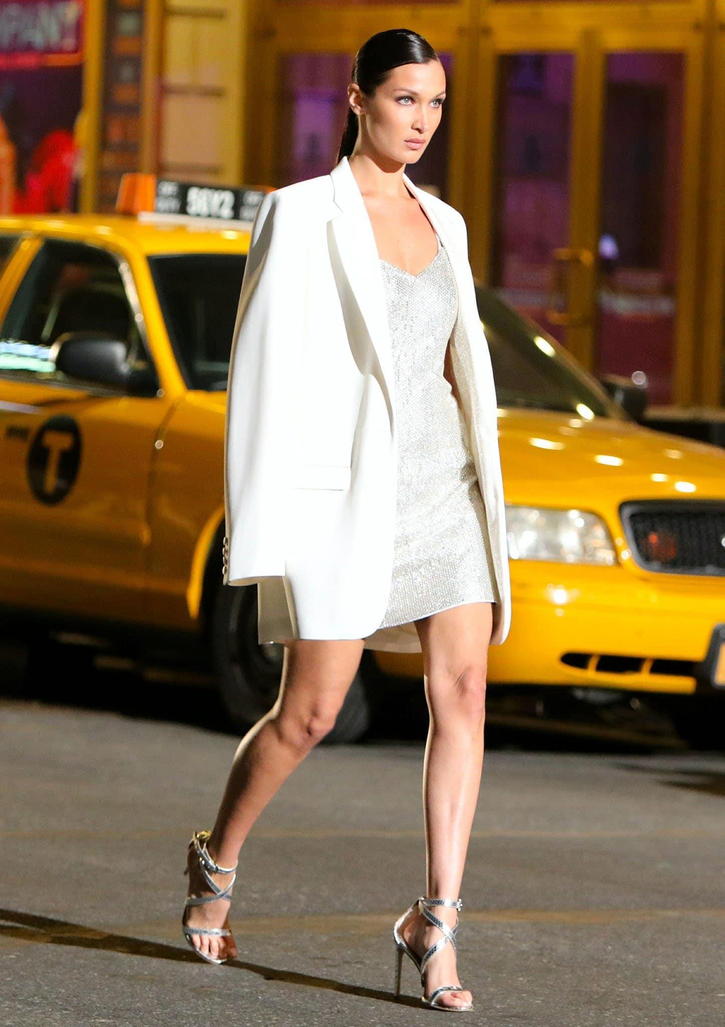 Bella Hadid models Michael Kors' sparkly white mini dress and oversized white blazer