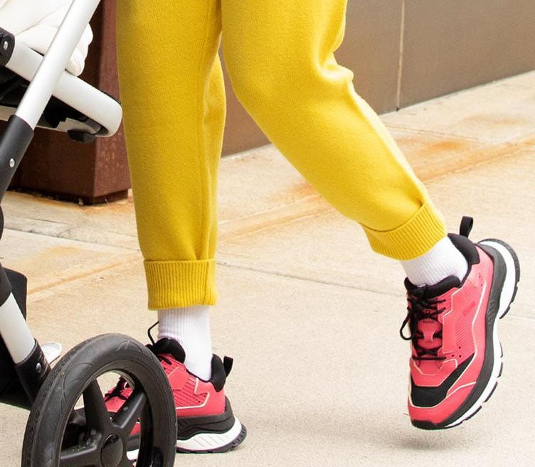 Gigi Hadid adds more color to her vibrant look with bold red Berluti Gravity trainers