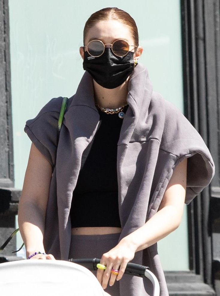 Gigi Hadid styles her athleisure with multiple multicolored The Last Line earrings and Keane rings