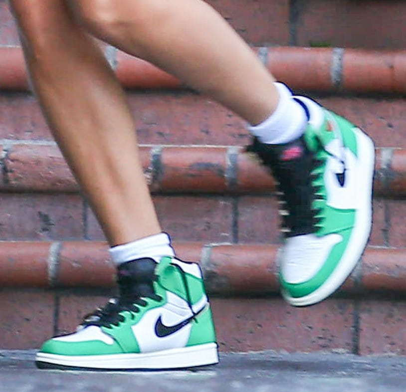 Hailey Bieber finishes off her street chic look with Air Jordan 1 Retro High OG in Lucky Green colorway