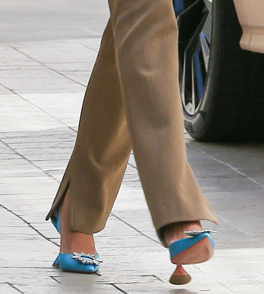 Hailey Bieber adds color to her retro look with Amina Muaddi Begum blue slingback pumps