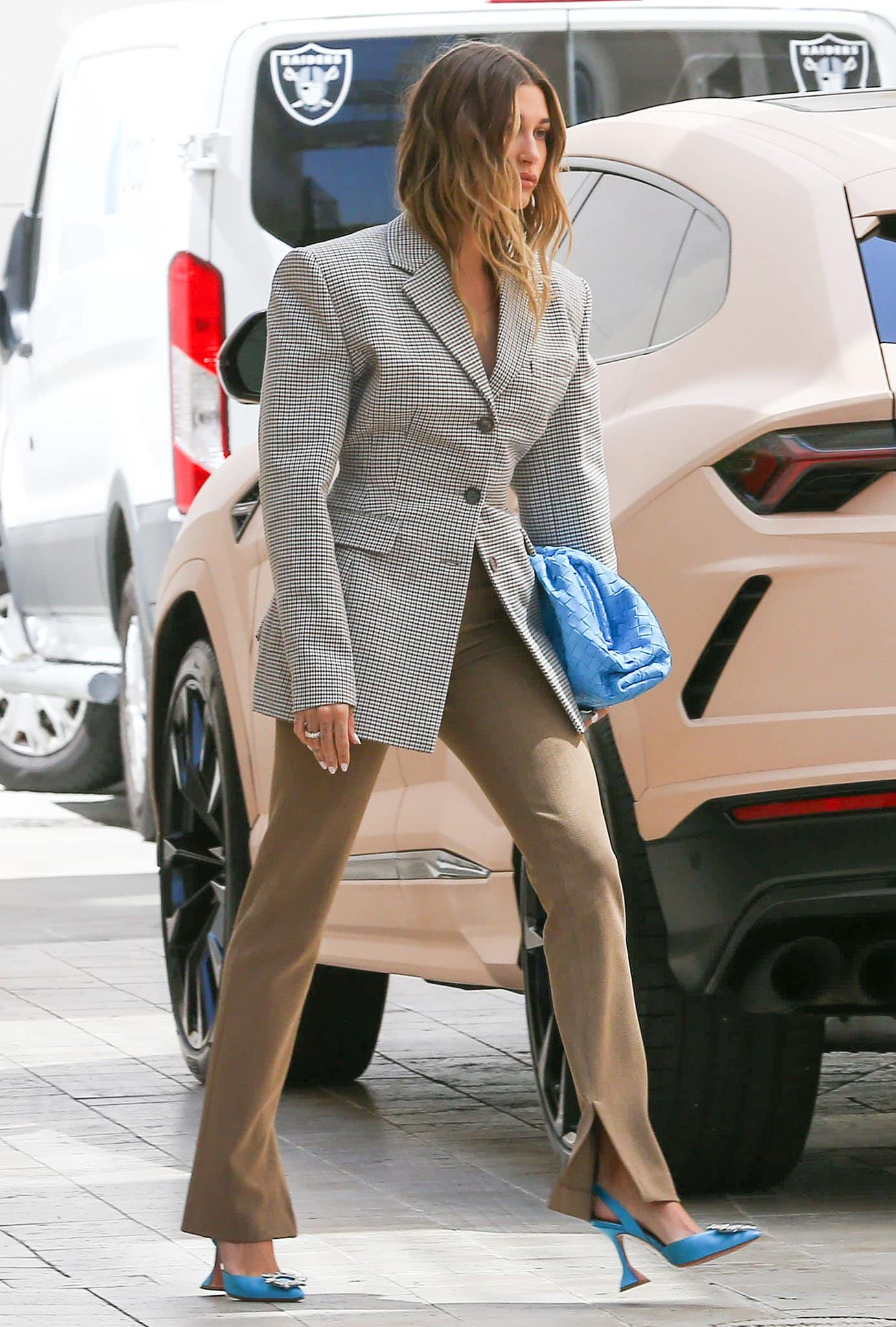 Hailey Bieber highlights her legs in Musier Paris brown pants with bottom slits