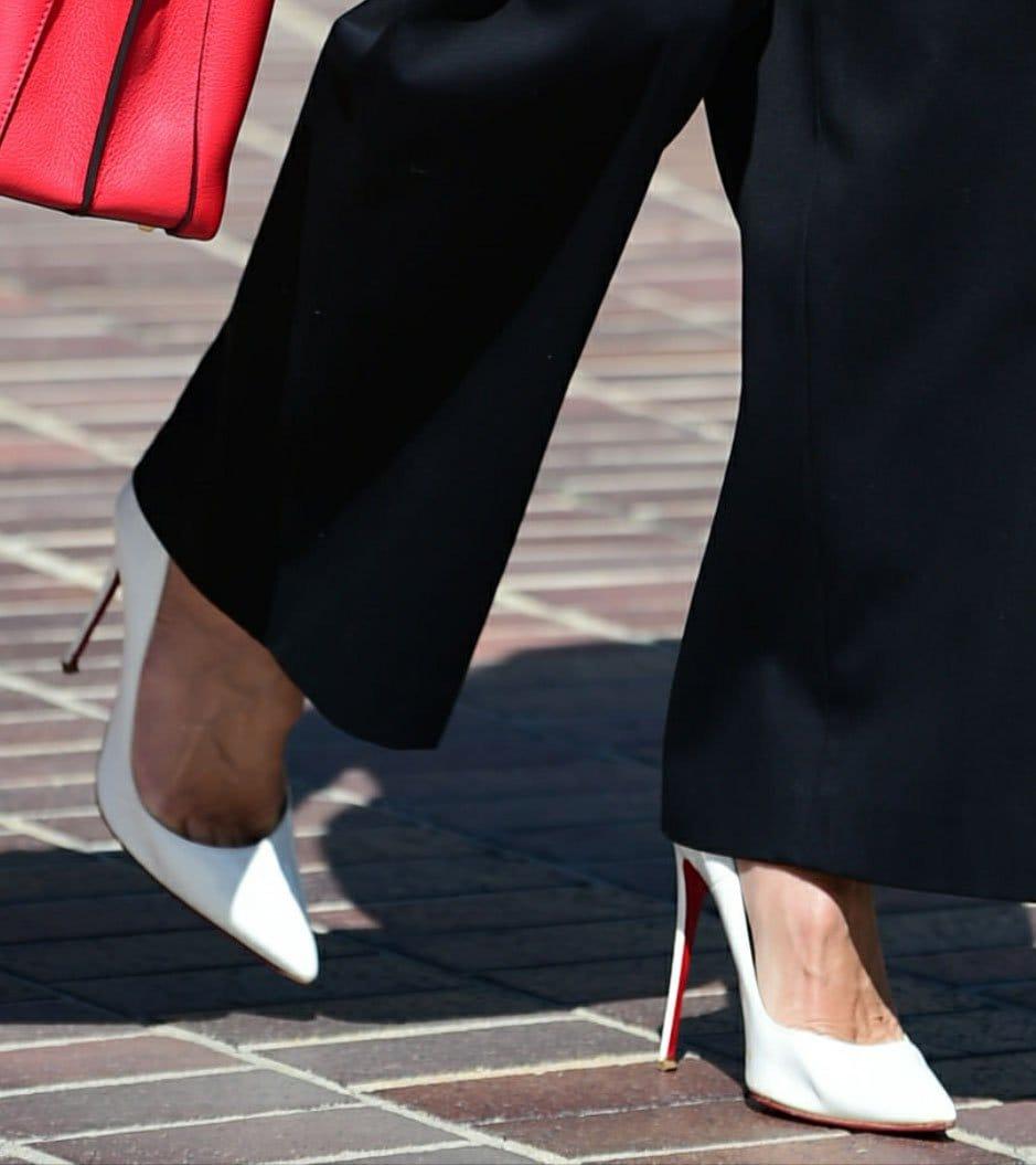 Heidi Klum shows off her feet in white Christian Louboutin So Kate pumps