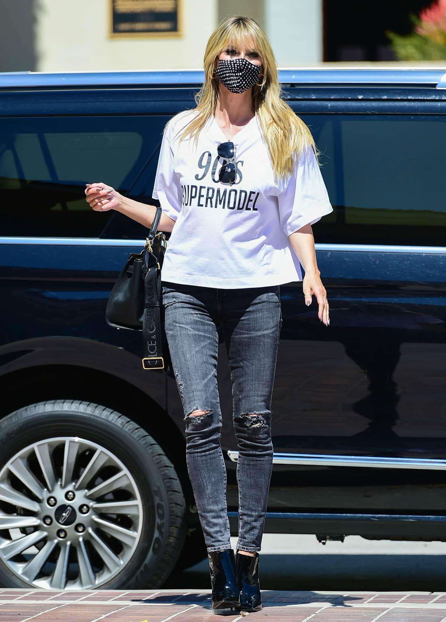 Heidi Klum kicks off America's Got Talent season 16 taping in Dolce & Gabbana '90s Supermodel tee on March 28, 2021