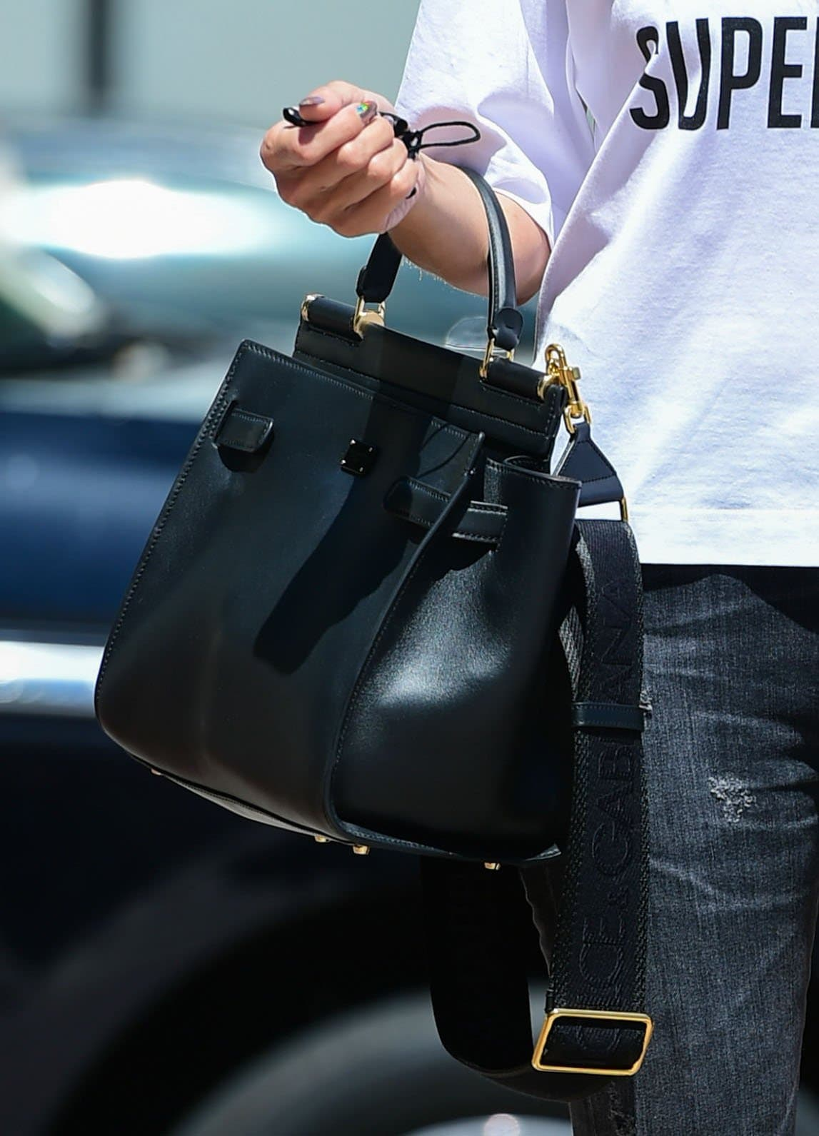Heidi Klum carries a black Dolce & Gabbana Sicily handbag