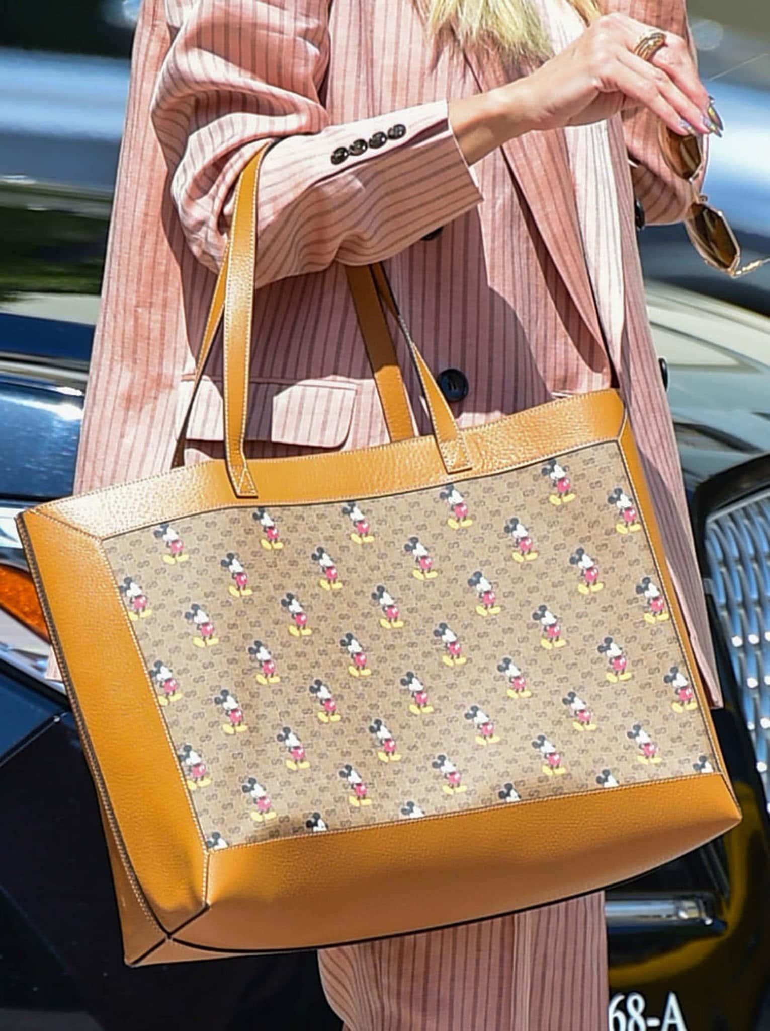 Heidi Klum carries a Gucci x Disney Mickey tote bag