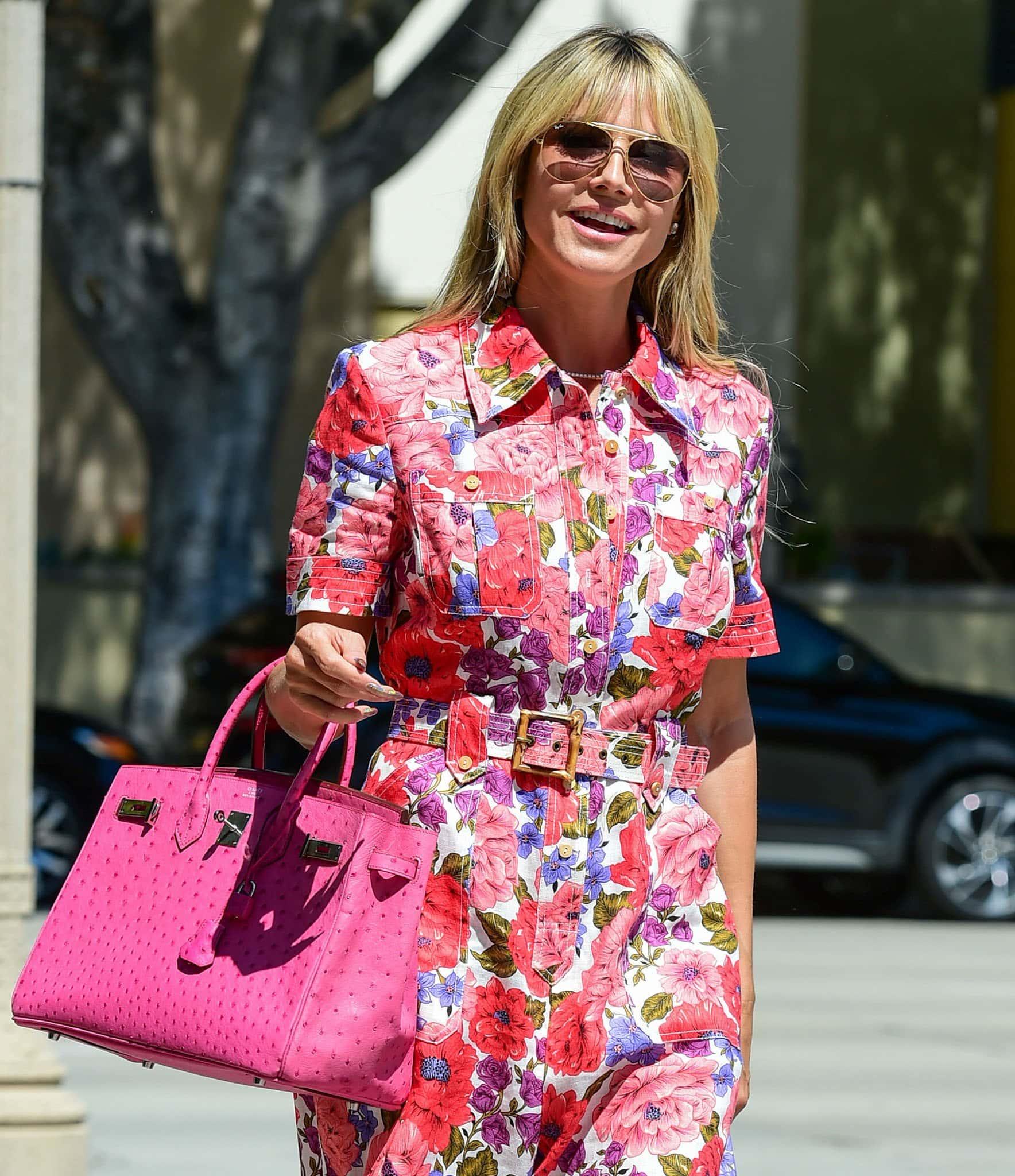Heidi Klum shields her eyes behind pink Ray-Ban aviators and carries her stuff in a pink Hermes Ostrich Birkin bag