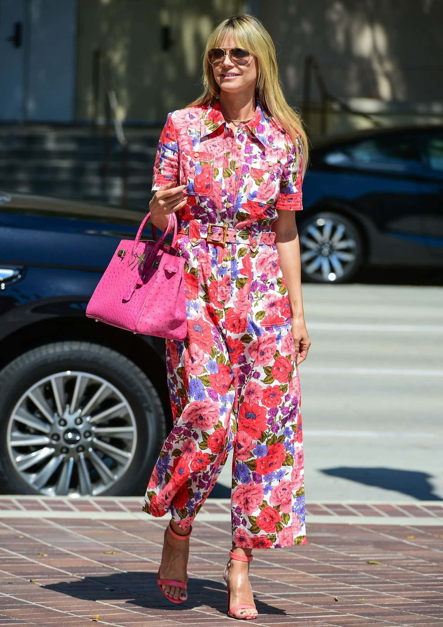 Heidi Klum goes for a girly look in Zimmermann Poppy floral-print linen jumpsuit on March 29, 2021