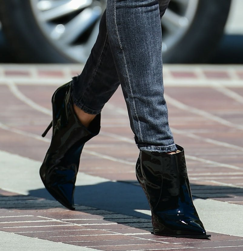 Heidi Klum finishes off a stylish outfit with patent leather pointed-toe booties