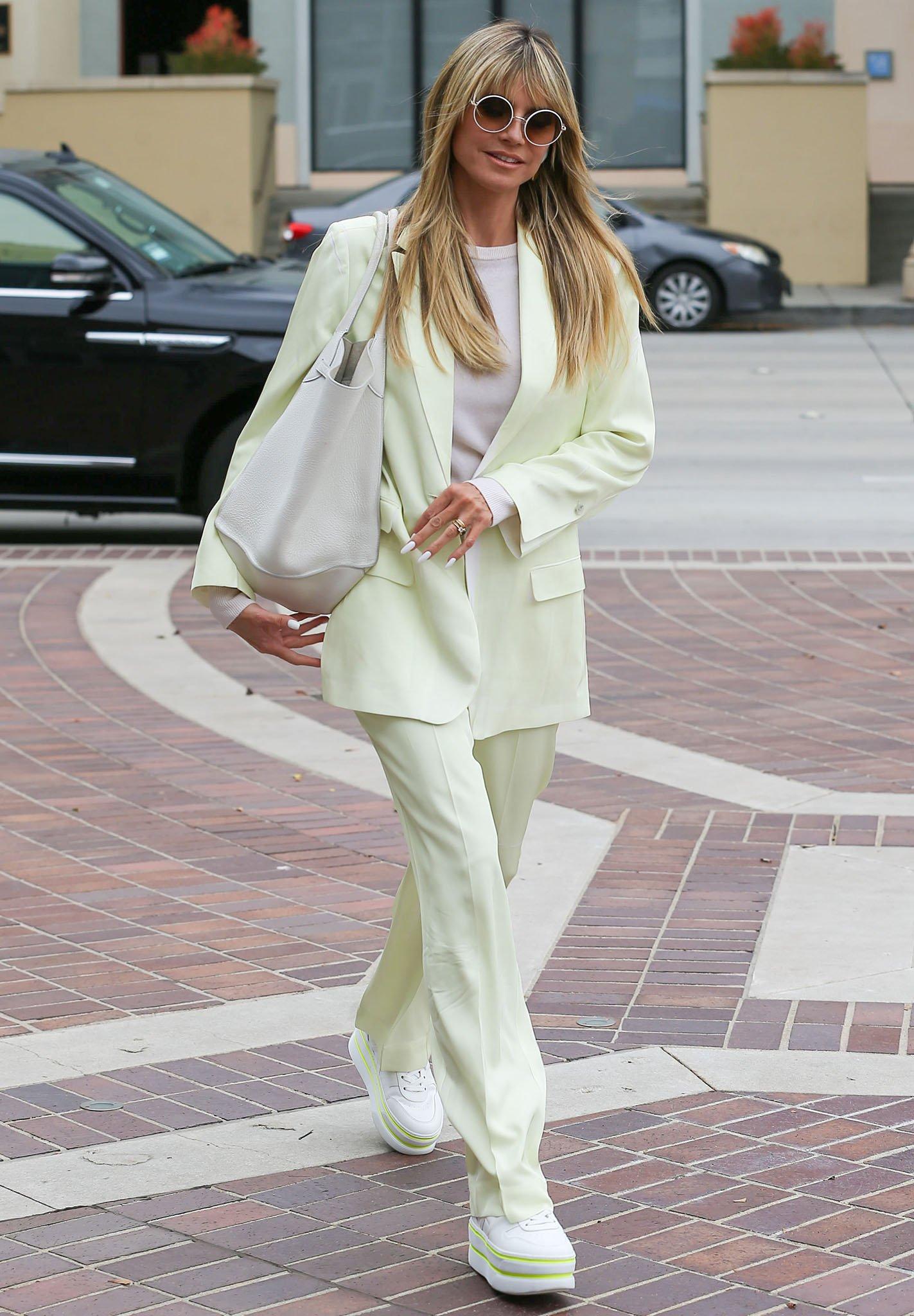Heidi Klum looks spring chic in honeydew pantsuit on April 23, 2021