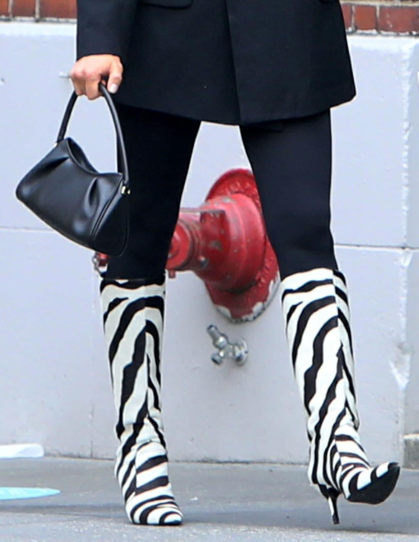 Irina Shayk adds a pop of pattern to her look with Magda Butrym zebra stripes boots