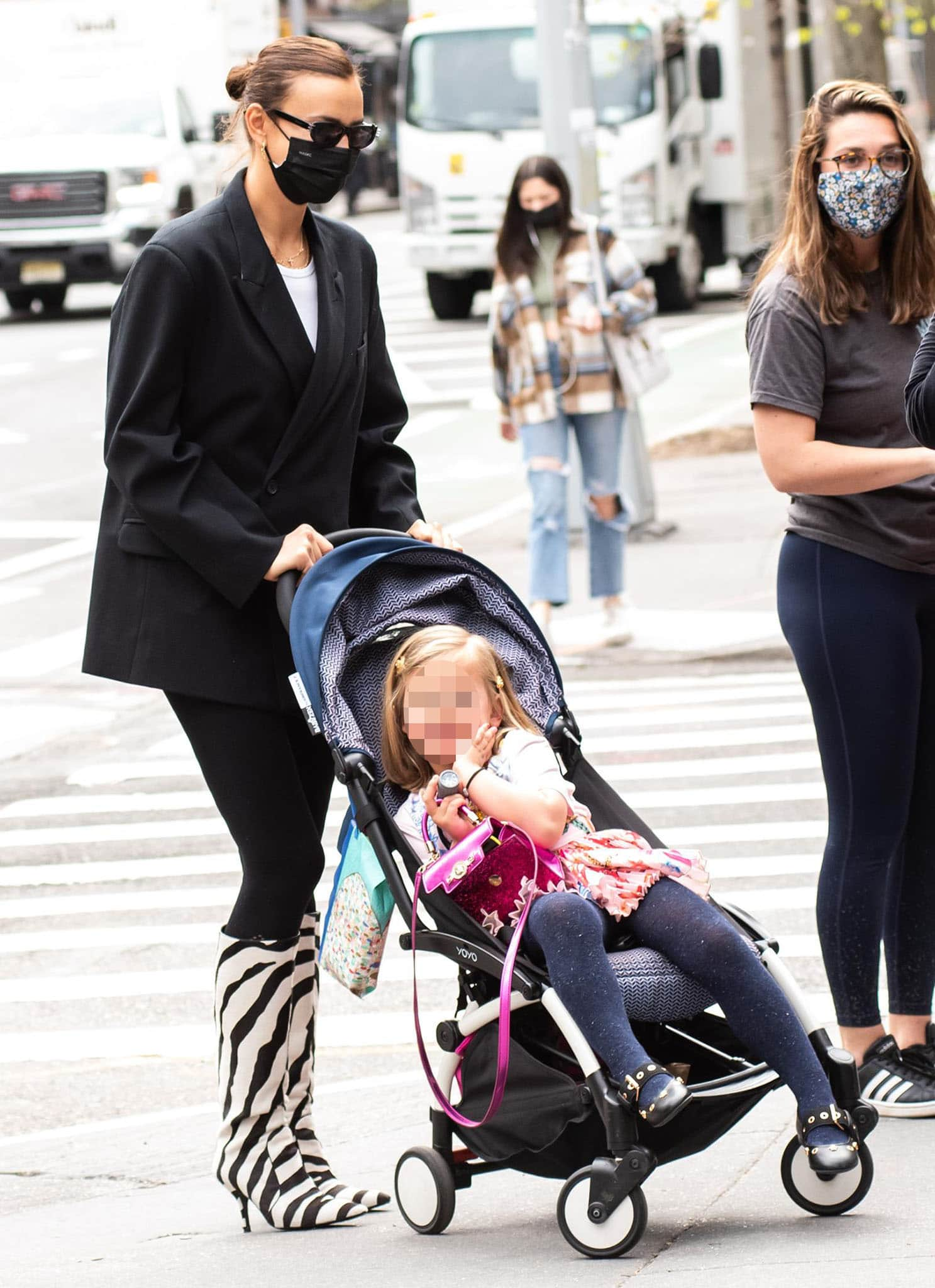 Irina Shayk opts for business casual attire as she pushes her daughter's stroller around SoHo