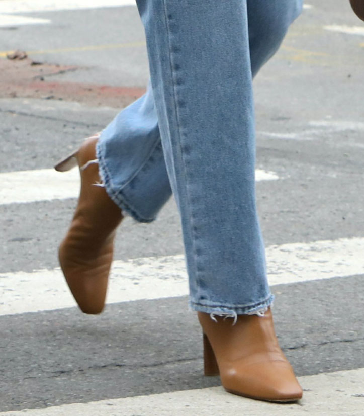 Irina Shayk finishes off her casual chic number with tan square-toe heeled boots