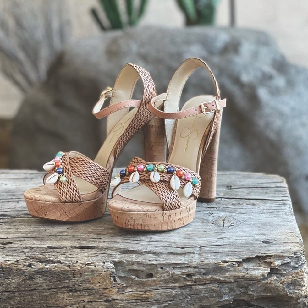 Summer-ready platform sandal from Jessica Simpson with polished beads and dangling shells that long to be back near the sea