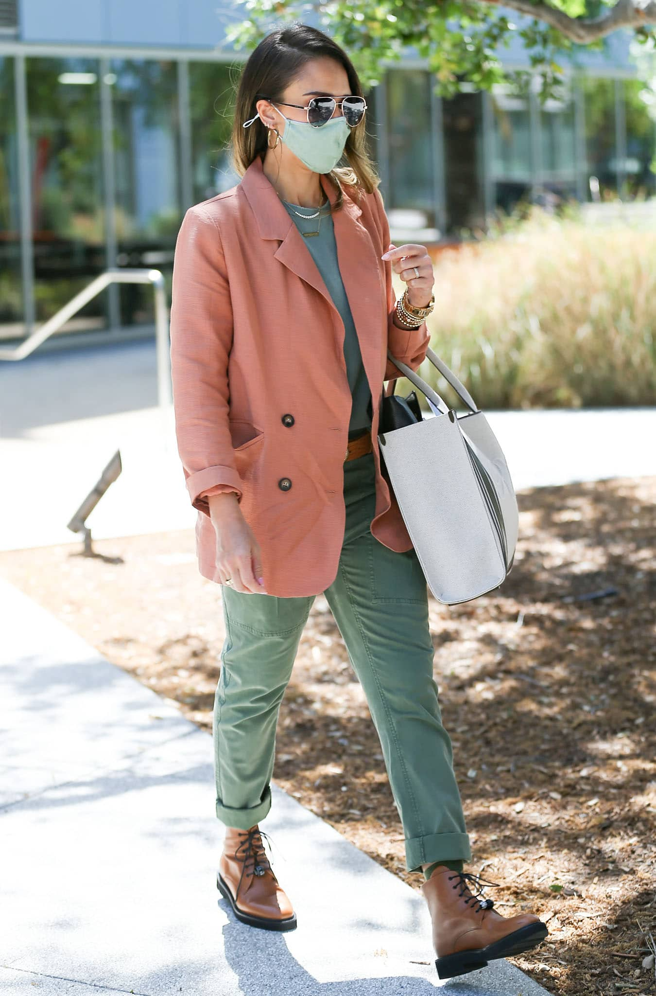 Jessica Alba defines spring-chic in sage green tee, green cargo pants, and peach blazer