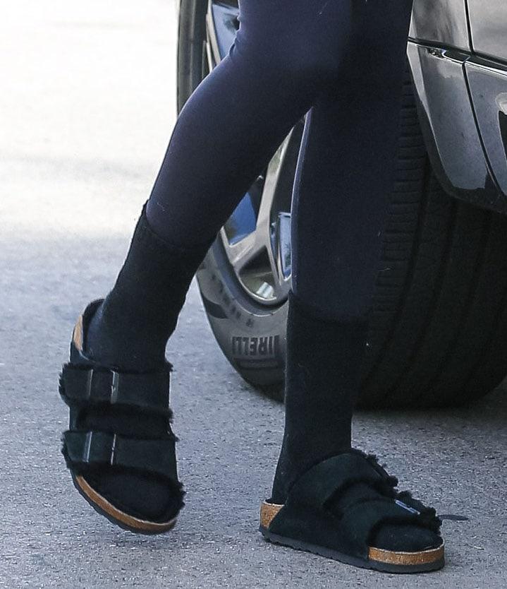 Kaia Gerber keeps a comfy look with fur-lined Birkenstock Arizona sandals