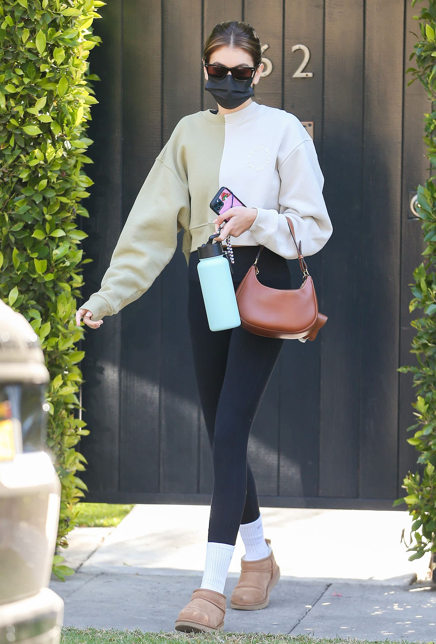 Kaia Gerber opts for a sleek Set Active x Maddie Cline color-block sweater with Alosoft lounge leggings on March 27, 2021