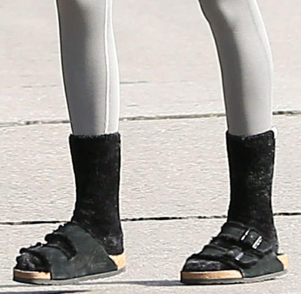 Kaia Gerber completes her Pilates outfit with UGG Leda cozy socks and Birkenstock fur Arizona sandals