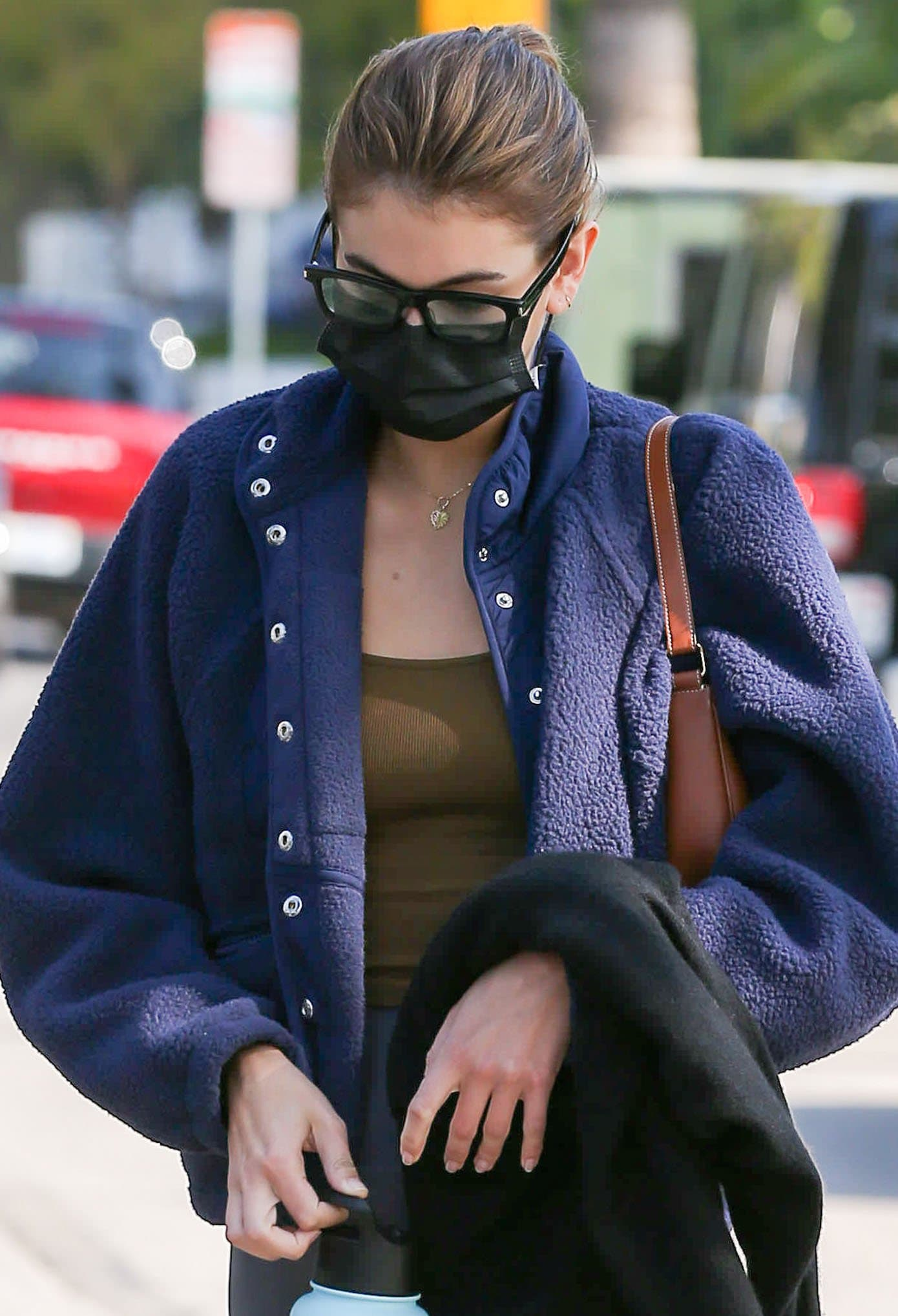Kaia Gerber looks chic in her geeky black-framed sunglasses
