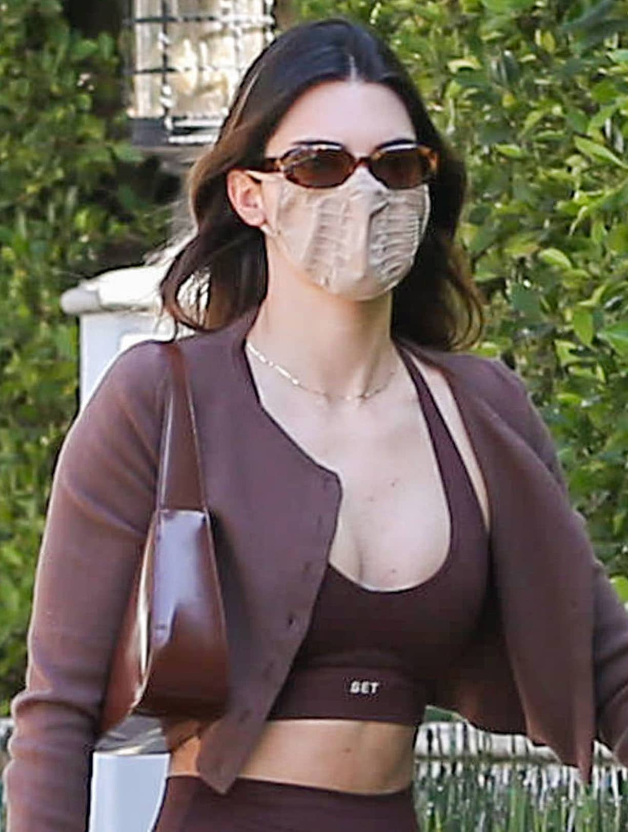Kendall Jenner keeps things low-key with Dmy by Dmy sunglasses and a Skims face mask