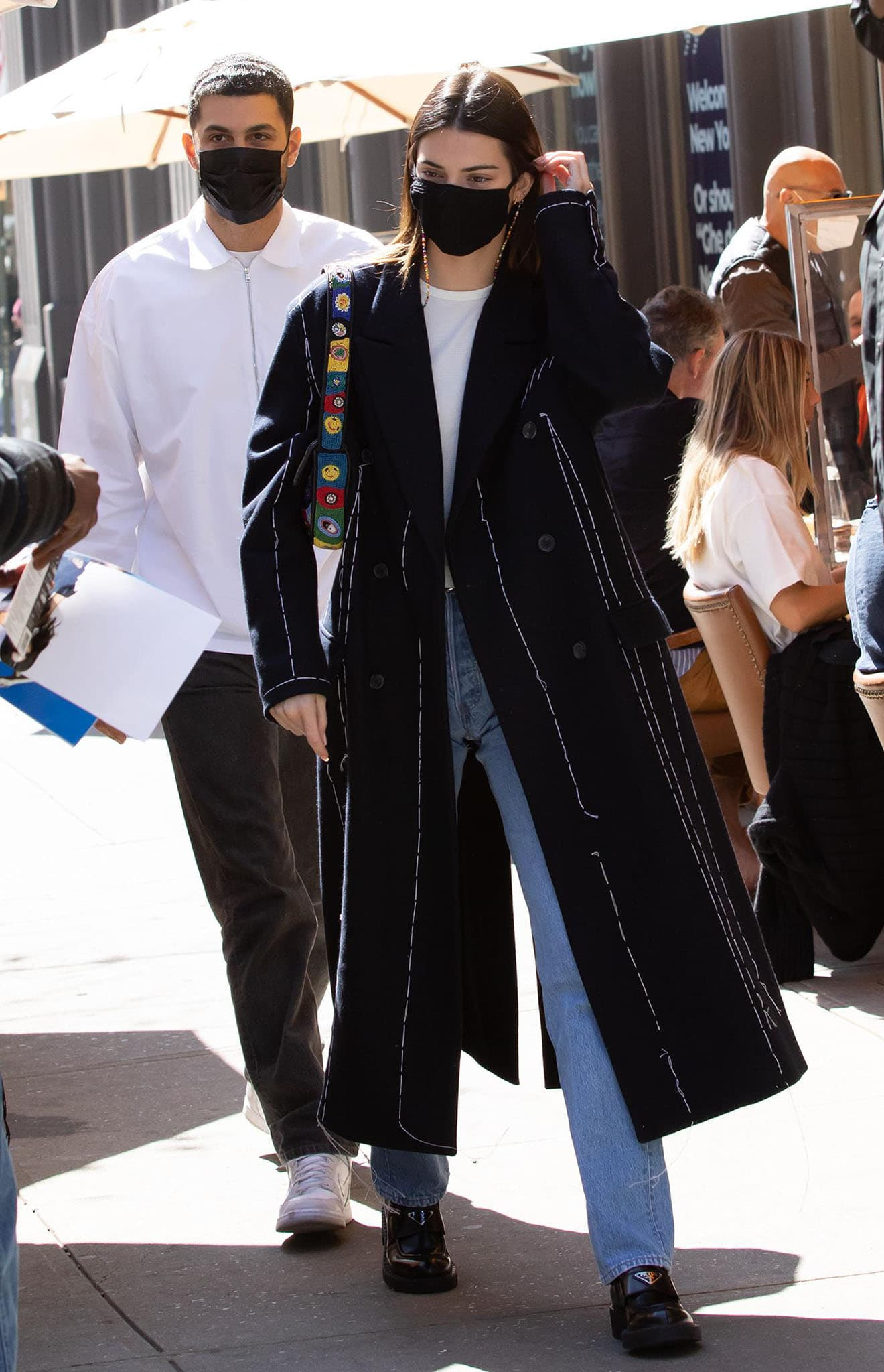 Kendall Jenner, pictured in a Rohk embroidered coat, Still Here jeans, and Prada leather loafers, is currently dealing with death threats and stalking incidents
