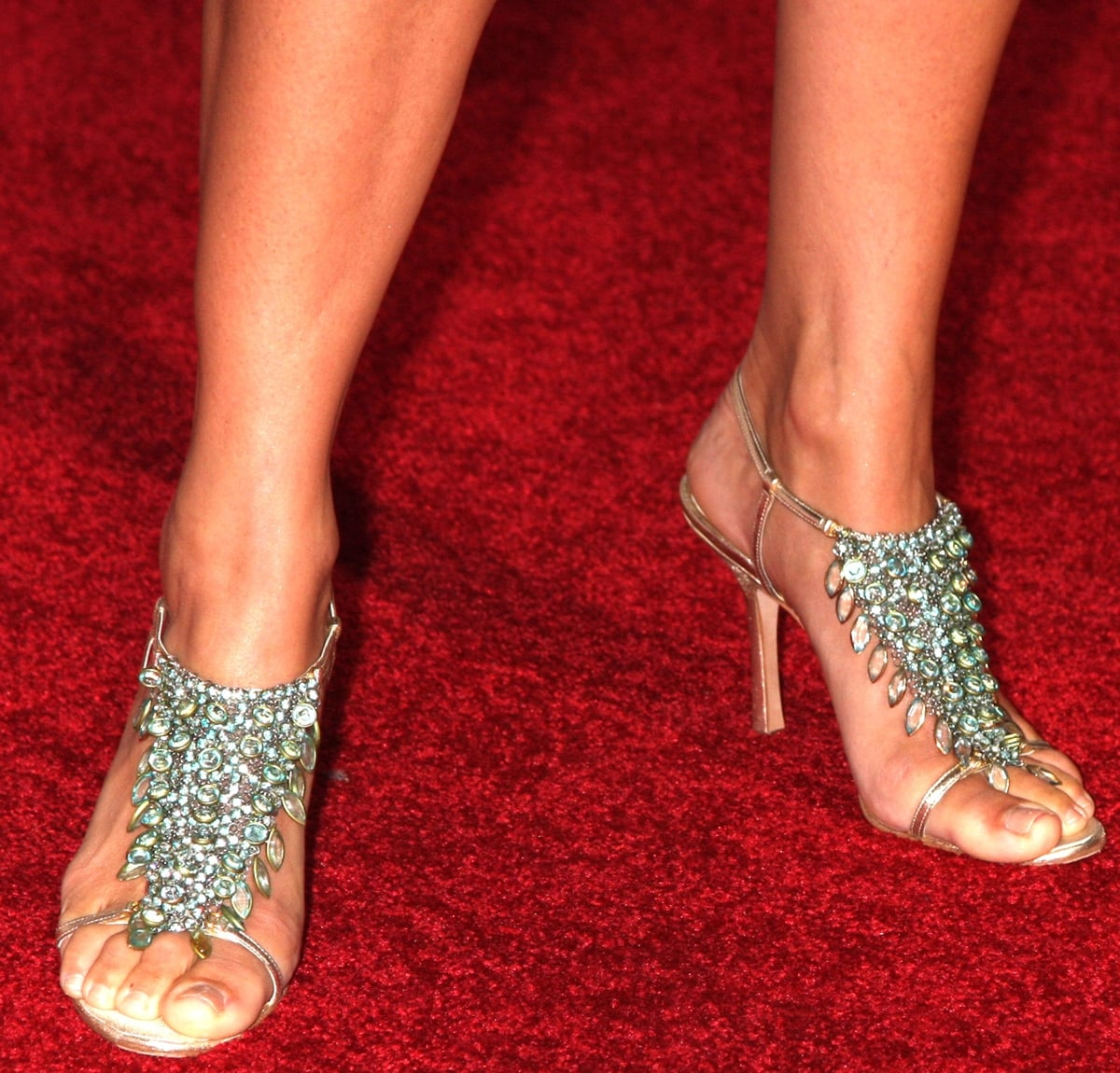 Lori Loughlin shows off her size 8 (US) feet in crystal-embellished high heels