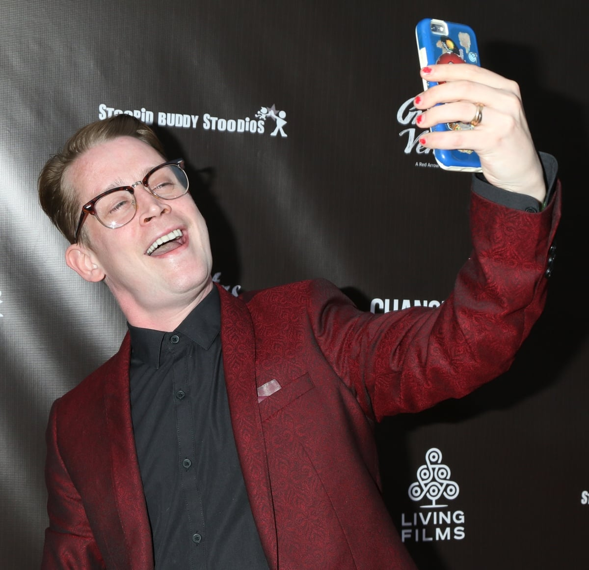 """Macaulay Culkin shows off his teeth while taking a selfie at the LA Premiere of Gravitas Ventures' """"Changeland"""""""