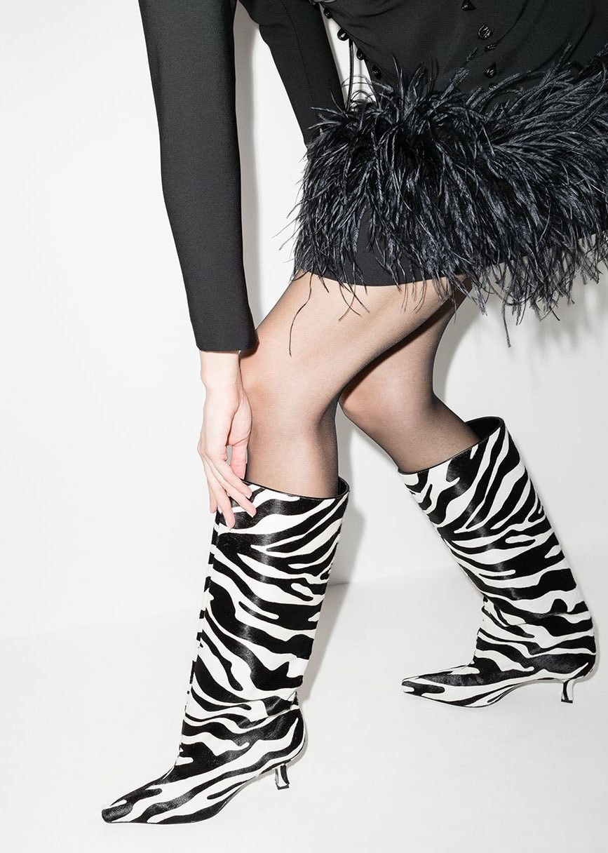 Magda Butrym's knee-high boots feature zebra stripes made from pony hair