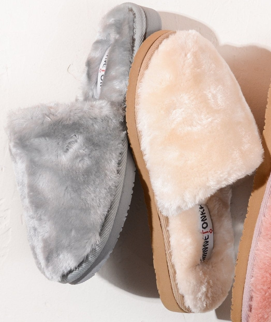 Minnetonka's plush, cozy Lora slippers reinvent the classic scuff silhouette with fluffy faux fur and gorgeous color options