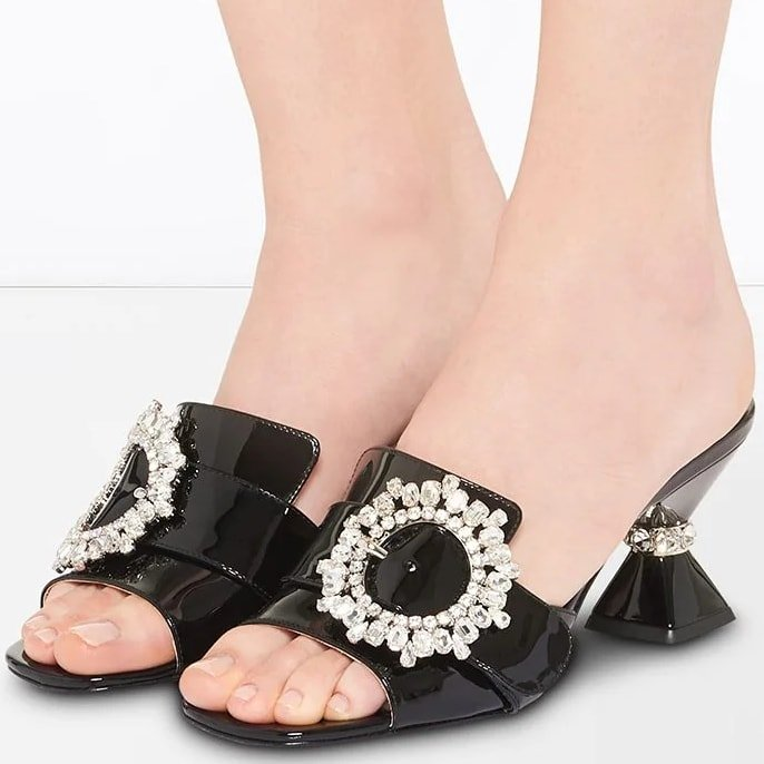 Slip into these embellished buckle Miu Miu mules and add some spark to your day