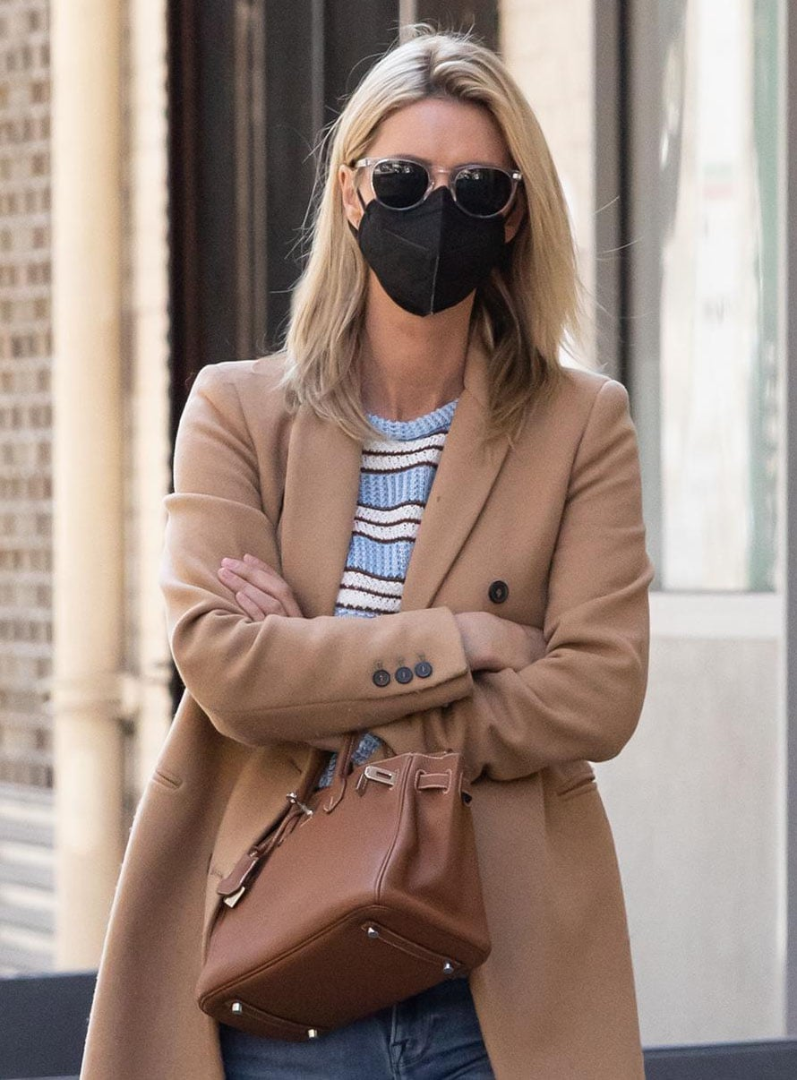 Nicky Hilton covers her face with sunglasses and a face mask and carries a tan Hermes Birkin bag