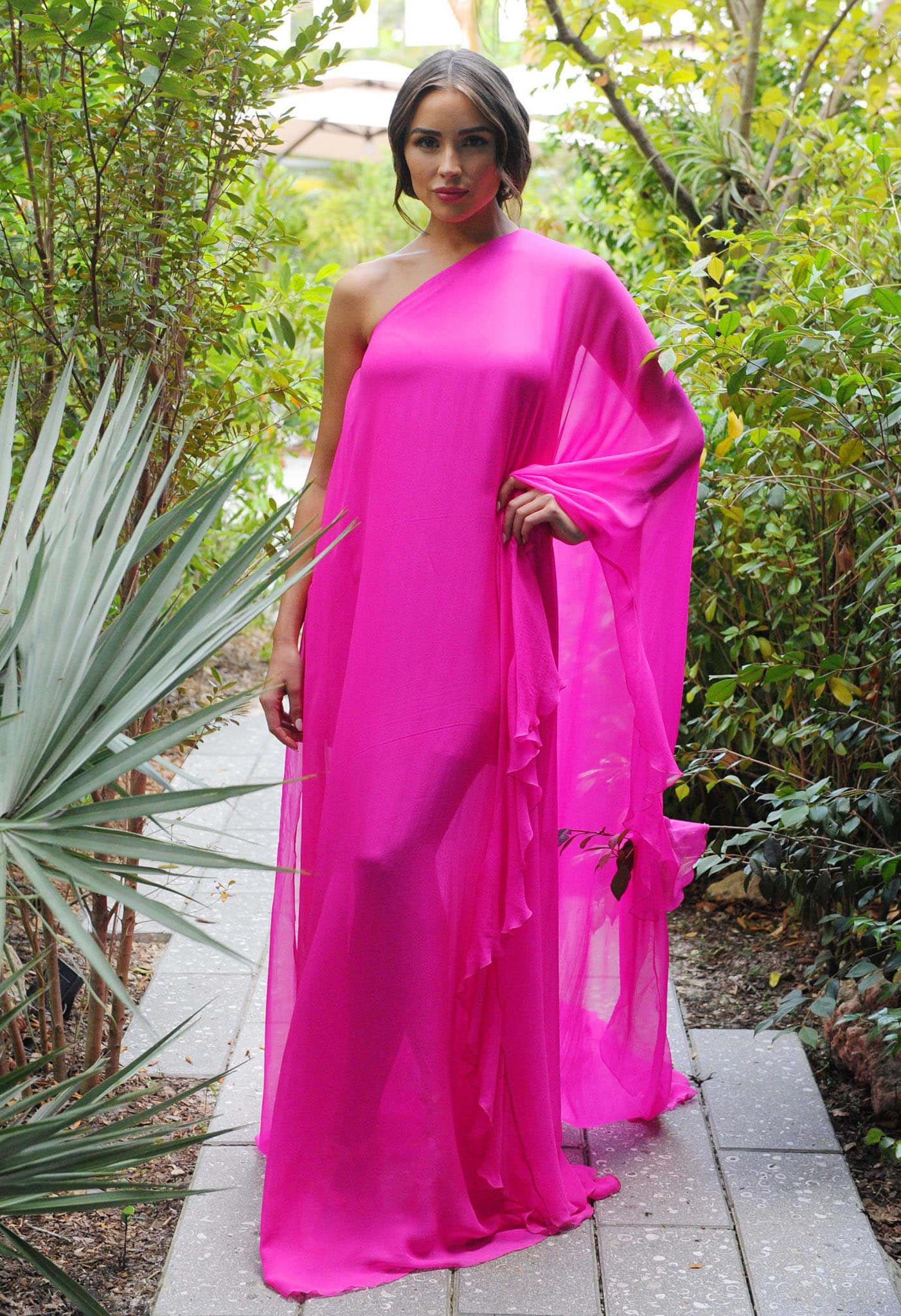 Olivia Culpo stuns in a Grecian-style fuchsia pink silk-chiffon Valentino Spring 2021 gown