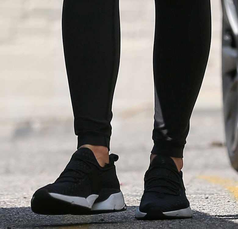 Olivia Munn slips into a pair of dominant black Avre Infinity Glide shoes