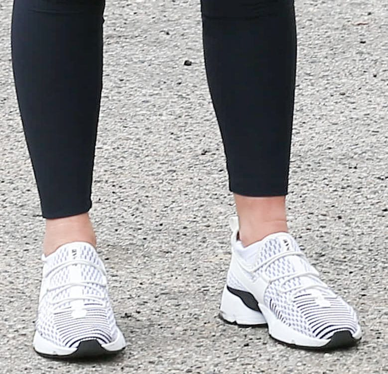 Olivia Munn completes a black-and-white athleisure with Avre Infinity Glide shoes