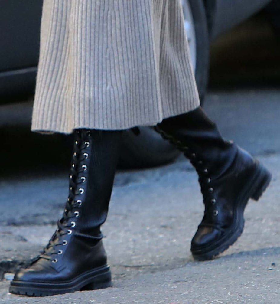 Olivia Palermo completes her stroll outfit with Gianvito Rossi knee-high combat boots