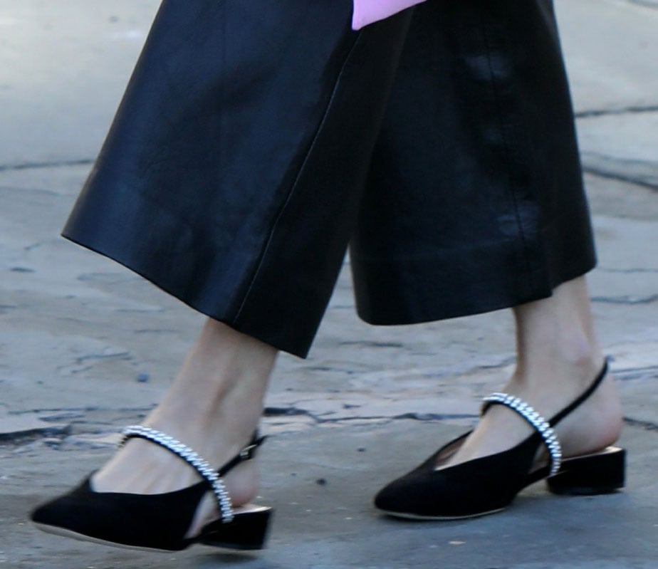 Olivia Palermo amps up the feminine vibe of her look with crystal-embellished pointed-toe slingback flats