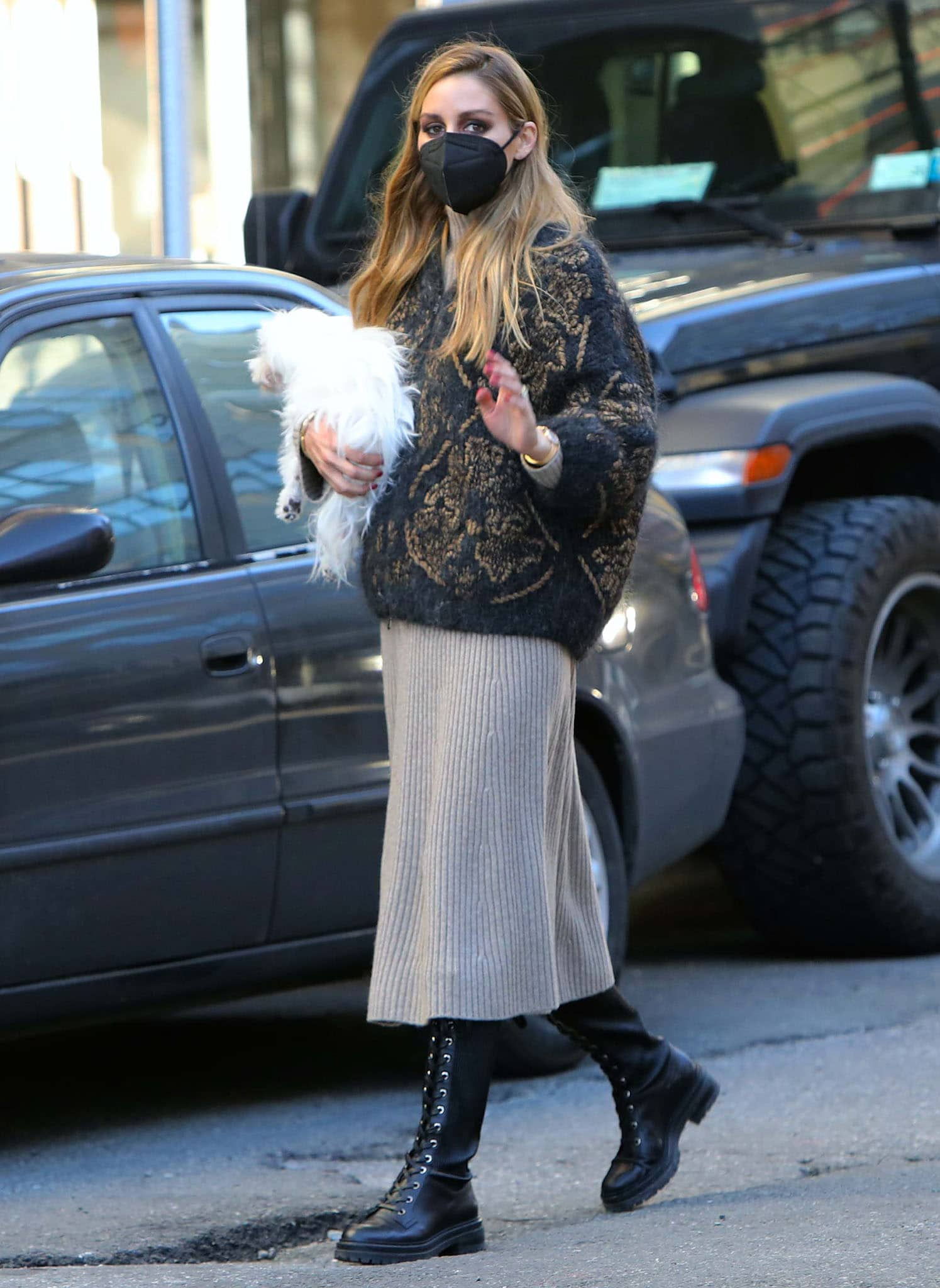 Olivia Palermo rocks a transitional spring outfit consisting of a rib-knit dress and a Brunello Cucinelli cardigan