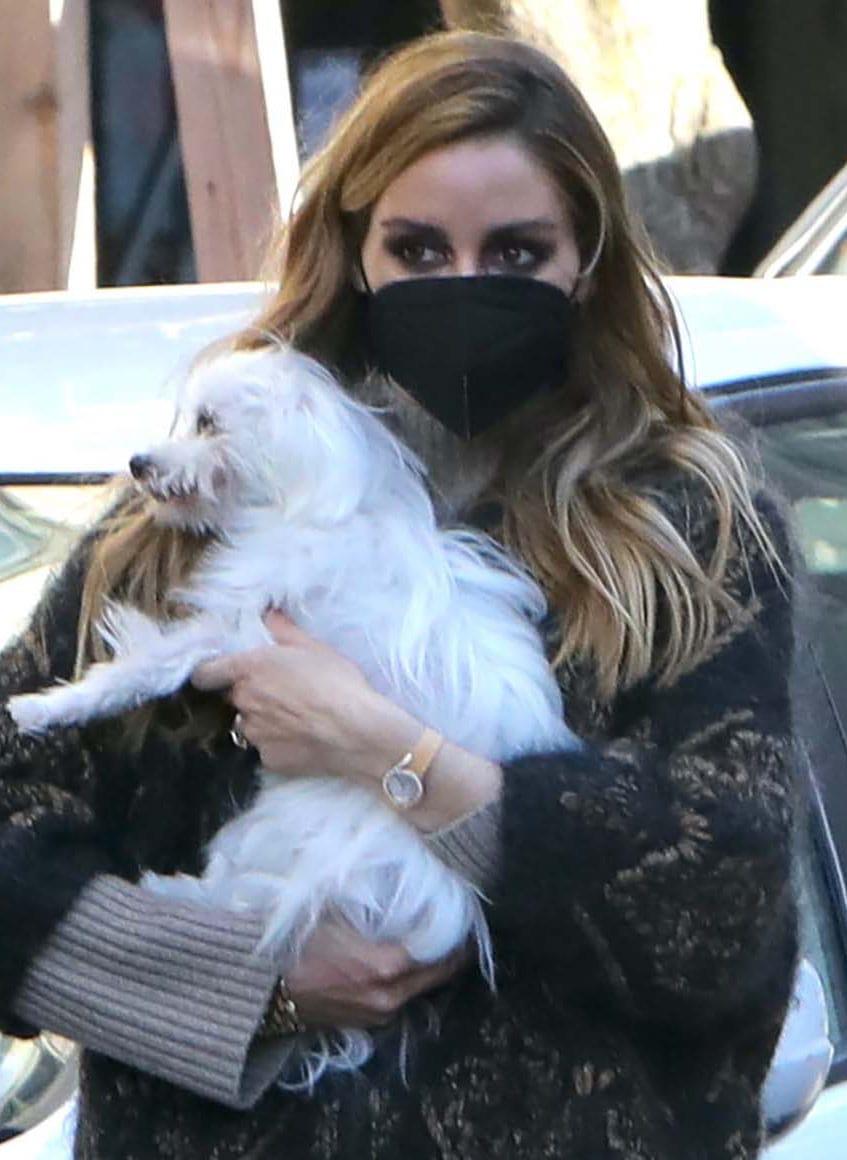 Olivia Palermo looks fierce with smokey eye-makeup and loose wavy tresses