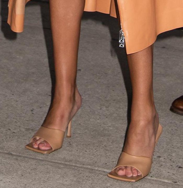 Rosie Huntington-Whiteley reveals bare legs and slips into Bottega Veneta Stretch Leather sandals
