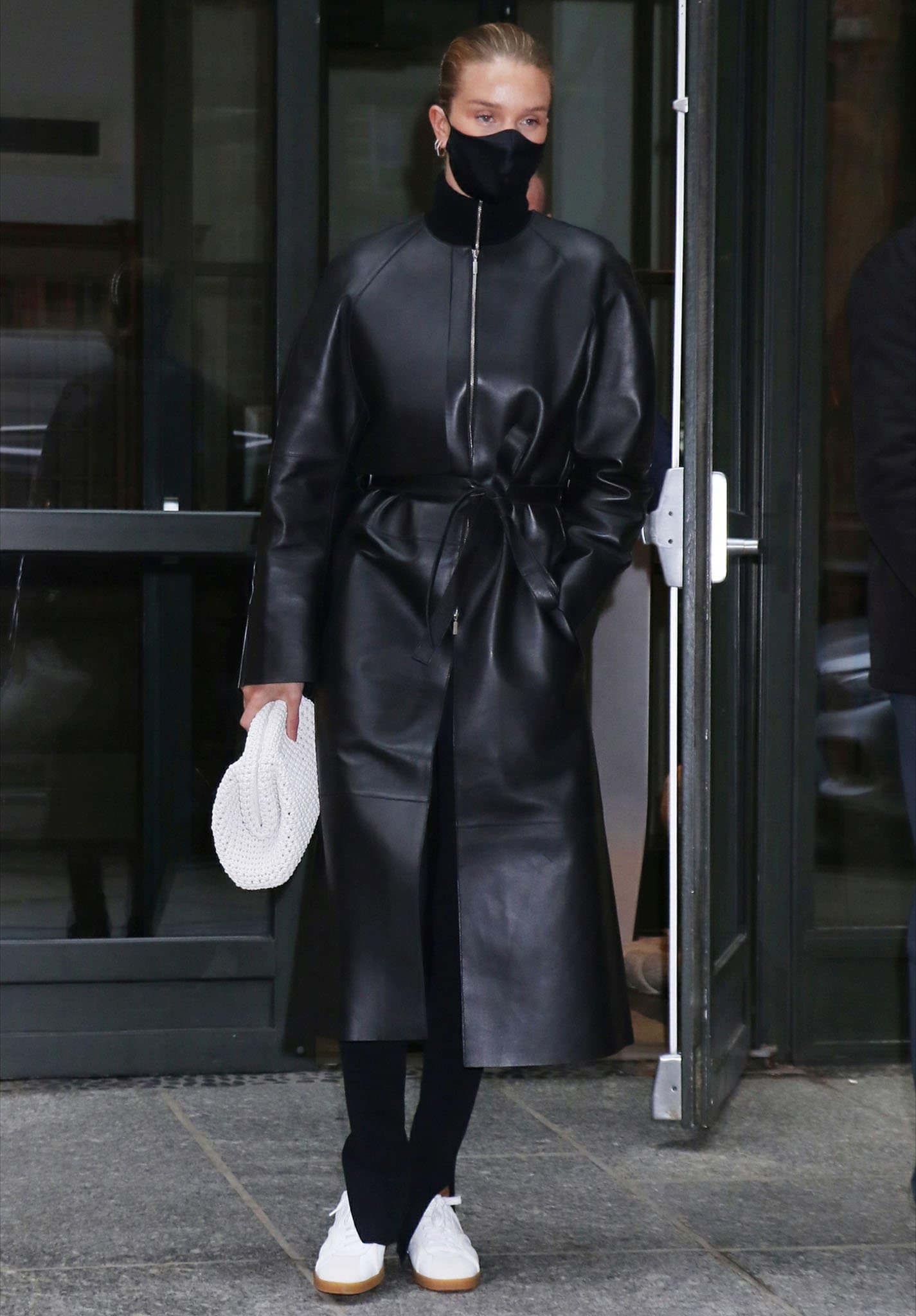 Rosie Huntington-Whiteley in Toteme trench coat, merino wool sweater, and high-rise leggings