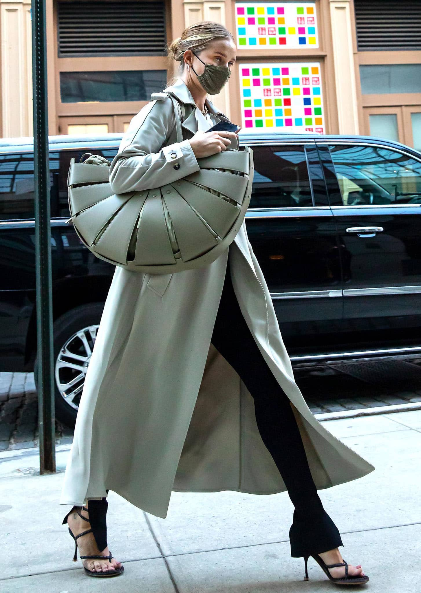 Rosie Huntington-Whiteley dons a Bottega Veneta trench coat with Toteme tee and The Row jeans