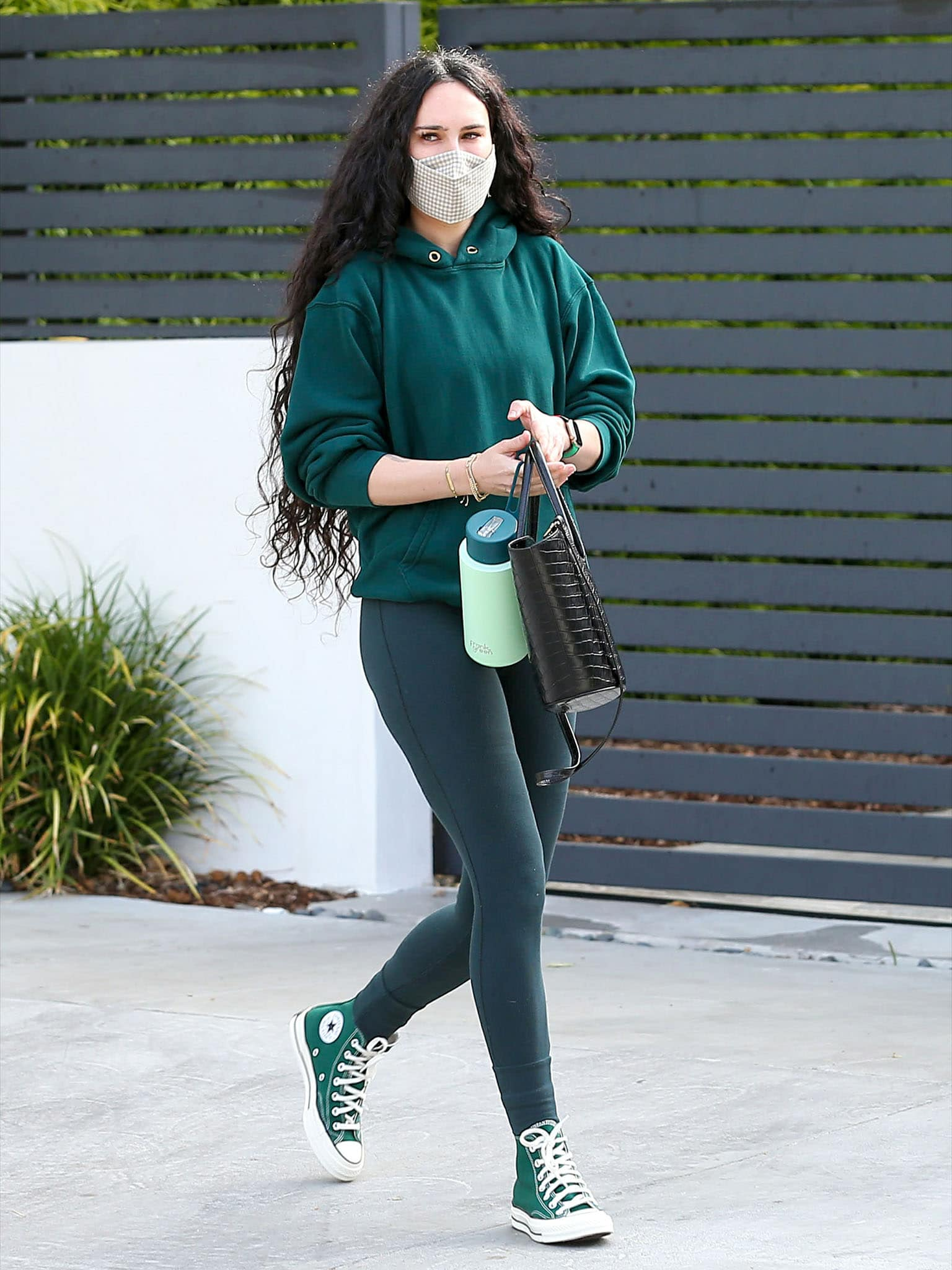 Rumer Willis opts for head-to-toe green workout outfit, with a green hoodie and green leggings